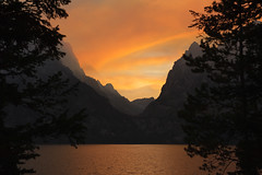 Sunset at Cascade Canyon (bhophotos - not for much longer) Tags: travel sunset red orange usa lake mountains nature water colors yellow clouds landscape geotagged nikon smoke wyoming tetons lt grandtetonnationalpark jennylake cascadecanyon d700 2470mmf28g jacksonholevalley bruceoakley bhophotos