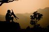 A boy playing with his goat - Pokhara, Nepal (samthe8th) Tags: nepal light silhouette nikon kiss sam hiking surreal goat goats works anapurna anapurnas d700 flickrchallengewinner herowinner ultraherowinner thepinnaclehof kanchenjungachallengewinner tphofweek97