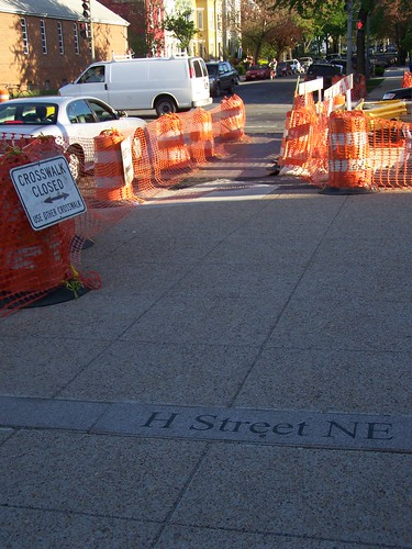 H Street NE marker placed in the sidewalk