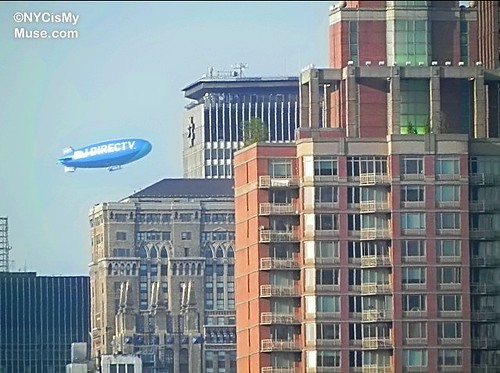 DIRECTV Blimp passing by Met Life Building in NYC on its way to the Mets game