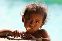 Portrait of a cute little girl in Timor, Indonesia. (cookiesound) Tags: trip travel summer vacation portrait holiday travelling girl smile face closeup canon indonesia photography fotografie cyan menschen littlegirl timor canoneos cutegirl indonesien reise travelphotography traveldiary reisefotografie portraitgirl reisetagebuch nemberala girlindonesia peopleindonesia portraitindonesia nisamaier portraitoflittlegirl ulrikemaier peopletimor cyanbackground menschenindonesien reisefotography littlegirlindonesia girlintimor