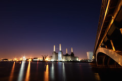 Battersea Power Station (TheFella) Tags: uk longexposure greatbritain bridge blue chimney england sky orange slr london water station thames architecture night digital plane canon reflections river stars landscape eos lights photo europe arch power purple unitedkingdom capital railway landmark explore trail nighttime photograph processing slowshutter gb dslr battersea frontpage riverthames powerstation chimneys pimlico railwaybridge batterseapowerstation archbridge postprocessing 500d planetrail grosvenorbridge londonlandmark explored explorefrontpage victoriarailwaybridge brickcathedral