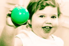 Spokesperson (CarbonNYC) Tags: party green girl smile smiling ball toy happy holding toddler firstbirthday leia selectivecolor greenball carbonnyc