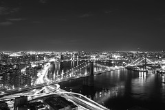 (Vitaliy P.) Tags: park street bridge light bw white black reflection cars monochrome brooklyn night clouds moving nikon long exposure downtown traffic time manhattan airplanes headlights southstreetseaport brooklynbridge planes manhattanbridge gothamist waterstreet williamsburgbridge 59th d80 18135mm vitaliyp gettysubmitted clusteroflights