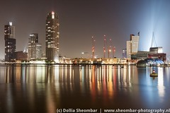 Rijnhaven Rotterdam (DolliaSH) Tags: city longexposure light sky urban haven holland color water colors architecture night canon reflections river photography lights noche photo rotterdam topf50 europe cityscape foto fotografie nightshot photos nacht harbour neworleans nederland thenetherlands illuminated le avond maas topf150 topf100 nuit kopvanzuid hotelnewyork notte stad erasmusbrug laspalmas noch zuidholland wilhelminakade wilhelminaplein 1755 nieuwemaas rotterdamzuid southholland 10000views 50d luxortheater rijnhaven nachtopname posthumalaan manhattanaandemaas visitholland canonefs1755mmf28isusm nederlandsfotomuseum hollandamerikakade canoneos50d demonchyplein dollias dolliash drijvendpaviljoen wierdsmaplein dolliasheombar vanderhoevenplein floatingpavillionrotterdam montevideoskyscraper