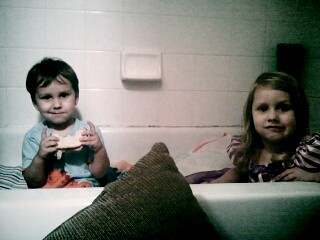 Cara and Ollie in the bathtub because of the tornadoes.