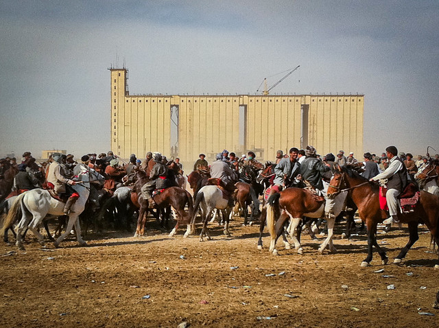 Soviet Bread Factory towering over Nowruz Buzkashi Match in Mazar