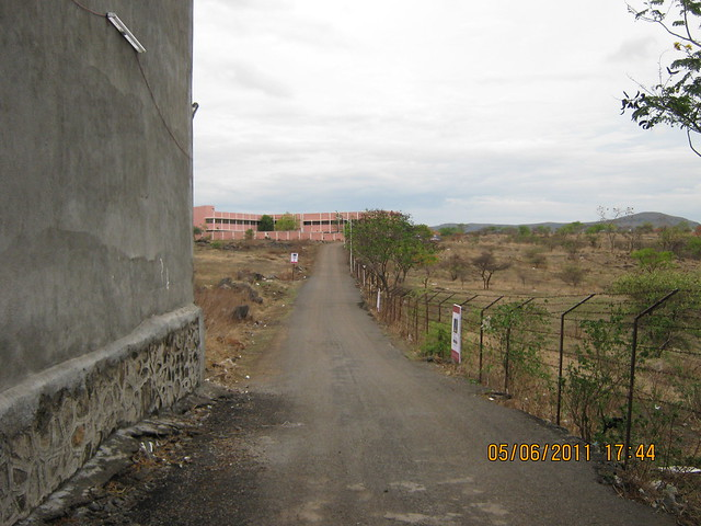 Compound of  Gurmukh Niwas Co-op. Hsg. Soc. Ltd and Narrow road to Pristine East Winds, Wagholi, Nagar Road, Pune 411 027