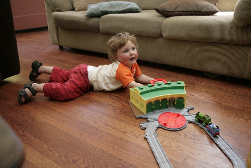 Playing with his trains.