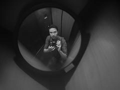 the photographer (Nick Today) Tags: portrait white black reflection pen self mirror f14 elevator lofi olympus fujian legacy 25mm ep2 selfie cmount