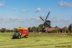 Almost Harvest month (Stephan Neven) Tags: harvest grass mowing tractor windmill bonrepas dutch indiansummer sky blue netherlands landscape outdoor agricultural farmer
