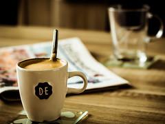 Coffee break (Funky Faro) Tags: coffee tea break newspaper 50mm dof vintage