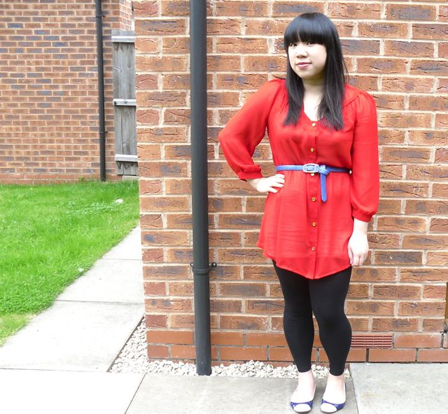 Red outfit and blue belt