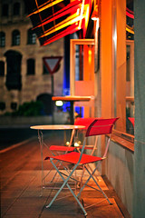 wednesday evening (baaasti) Tags: red rot sign bar night canon outside spring chair nuremberg sidewalk stuhl brgersteig ef50mm14