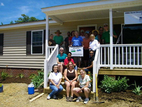 Second step from bottom (center) is Ms. Brandy Russell the Homeowner. Surrounding her are all of the Rural Development Staff that helped with the final landscaping and construction duties during the Volunteer Day held June 15th...
