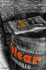 Newspaper On A Barrel (Light+Shade [spcandler.zenfolio.com]) Tags: monochrome bar canon geotagged eos newspaper cafe spain europe barrel andalucia espana andalusia hdr highdynamicrange lightshade selectivecolour 2011 arcosdelafrontera tonemapped tonemapping hdrphotography 450d canoneos450d hdrphotographer stephencandler stephencandlerphotography spcandlerzenfoliocom