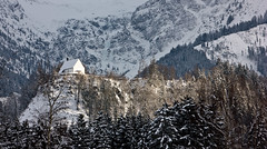 Little Chapel on a Hill (Nataraj Metz) Tags: schnee trees winter mountain snow alps forest canon germany bayern deutschland bavaria europa europe chapel berge alpen wald bume deu gebirge kapelle allgu oberallgu fischen allgueralpen alpmountains eos550d fischenimallgu eosrebelt2i tamron18270mmf3563diiivcpzd