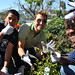 Lance Bass planting with students