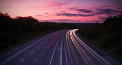 (drfugo) Tags: sunset red sky sun cars clouds landscape lights long exposure driving motorway headlights nd canon5d grad stacked cliche taillights lightstreaks m23 sigma28mmf18exdg windisreallyannoyingforthoseofuswithbudgettripods