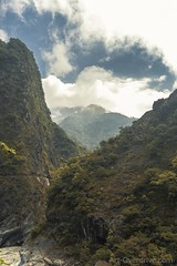 High in the Sky (Morgan Kinkel) Tags: blue red sky orange plants mountains green nature water yellow clouds river landscape asia view taiwan late gorge leafs taroko canoneos400d artoverdrivecom artoverdrive