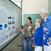 <p>Scripps graduate student Rosa Leon discusses her marine biology research with Scripps Day guests.</p>