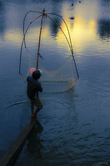 Fishing on Lake Bao Loc (-clicking-) Tags: life lighting morning light people lake fish water sunrise dawn fishing fisherman asia streetphotography streetlife vietnam fisher hardlife colorphotoaward bolc 100commentgroup bestcapturesaoi elitegalleryaoi artistoftheyearlevel3 artistoftheyearlevel4 ruby5 hbolc artistoftheyearlevel5 artistoftheyearlevel6