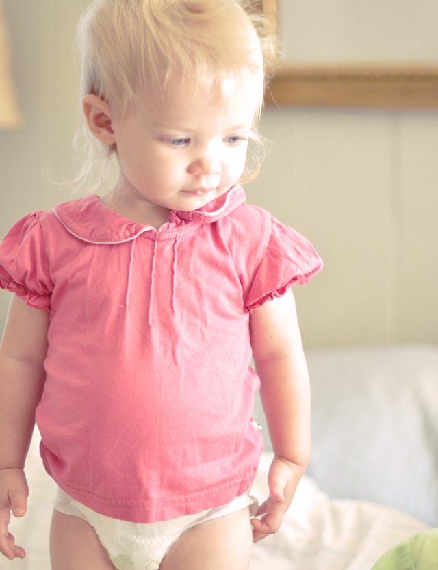 Delilah in a pink tshirt + toddler