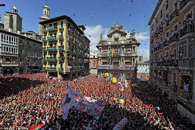 Sun, sangria and a sea of red... as Pamplona prepares for another gorefest at the running of the bulls  1
