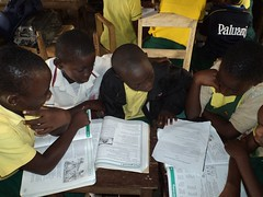 """children doing a group work in reading • <a style=""""font-size:0.8em;"""" href=""""http://www.flickr.com/photos/48668870@N02/6947281860/"""" target=""""_blank"""">View on Flickr</a>"""