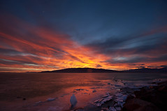 Mountain Explosion (Adam's Attempt (at a good photo)) Tags: blue sunset red sky orange mountain lake ice yellow clouds wow fire utah nikon rocks colorful lr3 d90 boatharbor dustonlens utahlakesunset mountainexplosion