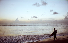 surfer (gandi purwandi) Tags: sunset bali slr film beach analog 35mm canon indonesia photography iso200 surf kodak surfer 28mm surfing a1 siluet f28 kuta soligor filmphotography colorplus