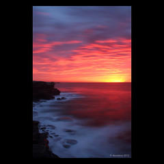 Cape Solander sunrise (Monochrome Visions) Tags: ocean longexposure sky sun seascape water clouds sunrise reflections rocks horizon sydney australia cliffs capesolander nd10stopfilter dexodexo douwedijkstra