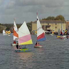 Millpond sailing (Skink74) Tags: 120 6x6 bronica c41 ektar100 emsworth england film hampshire s2a tetenal uk zenzabronicas2a ektar sailing dinghy millpond water sail s2ac044