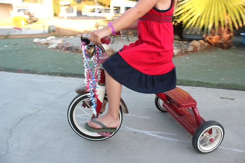 Tricycle with patriotic streamers