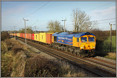 66721, Murcott, 4L22 (Jason 87030) Tags: gbrf freight cargo containers felixstowe hamshall midlands loop northampton wcml westcoastmainline northants skyn light november 2016 northamptonshire ts lineside location farm pigs murcott longbuckby sky clouds working diesel class66 shed livery
