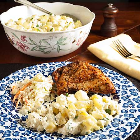 American (Mayonnaise) Potato Salad on plate with coleslaw and fried chicken