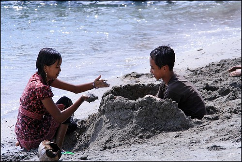 Playing Sand at Pasir Putih Beach
