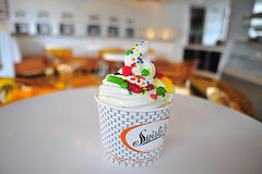 _DSC3022 (banditob) Tags: orange white cup shop photography cupcakes photo lincolnshire il cupcake swirl yogurt frozenyogurt toppings albertotrevino