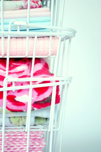 Baskets of cleaning cloths, dusters and towels