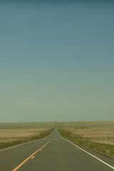 roll on, highway. (speckled_beckle) Tags: road rural highway ribbons colorado driving nowhere asphalt ontheroad throughthewindshield yellowstripe rebbeccaellaphotography