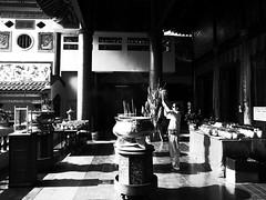 Blind Faith (Trim Reaper) Tags: travel light bw man sunglasses contrast temple photography blackwhite high alone buddha candid buddhist si praying malaysia penang ricoh kek glaring lok sooc grd3 grdiii