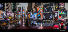 Times Square (Steve Rosset) Tags: city travel girls people urban panorama usa newyork cars beach boys rain june retail skyline architecture modern youth digital america buildings movie advertising square lights design marketing athletics twilight cosmopolitan media downtown day gloomy metro manhattan vibrant pano taxi towers ad central young vivid mcdonalds midtown explore commercial timessquare posters pedestrians billboards metropolis intersection times umbrellas 2012 rainny retailing steverosset