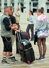 Welcome to Canary Wharf (_steve h_) Tags: street city urban woman man london lost candid streetphotography tights tourist luggage chain canarywharf suitcase dlr patterned haircur