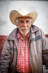 Man in white hat (Rebecca Danby) Tags: street portrait people man mexico cowboyhat cuetzalan