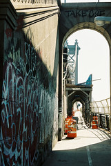 Manhattan Bridge (Marcelle Bradbeer) Tags: nyc sun ny newyork colour film architecture brooklyn america 35mm photography graffiti manhattan grunge streetphotography streetlife 35mmfilm manhattanbridge disposablecamera analogue archway grainy gafl17 gafslr gafl17slr marcellebradbeer