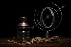 Nautical Still Life (Vinod_Sunder) Tags: stilllife gyro sidelight starboard lightpainting coir rope longexposure