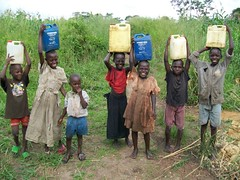 Success!  Children in Nyakarongo carry filled water containers on their heads