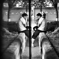 [343/365]: Duality (A. adnan) Tags: guangzhou china street two portrait blackandwhite man reflection lines project mirror nikon waiting conflict symmetric duality 365 busstation nikkor50mmf14d project365 365days bangladeshiphotographer dongfengdonglu aadnan613
