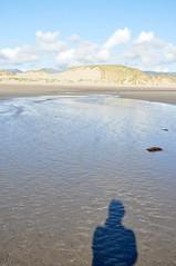 Shell Island Shadow (Nik Sibley) Tags: uk camping shadow sea sky beach water wales island coast sand britain shell campsite gwynedd shellisland