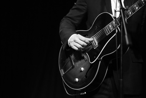 John Paul White of the Civil Wars strumming his guitar